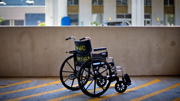 May 24, 2013: A wheelchair sits outside the Atlanta VA Medical Center in Atlanta. An internal investigation released in June 2014 that looked at wait times for all sorts of care across the VA system showed that new mental health patients were routinely forced to wait a month or more to start treatment. Not one of the 141 medical systems examined was able to meet the department's goal of getting all new mental health patients an appointment within 14 days. (AP/David Goldman, File)
