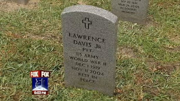 Photo shows the gravestone of Lawrence Davis Jr., a World War II veteran who was found to have been buried in a cardboard box in Florida.