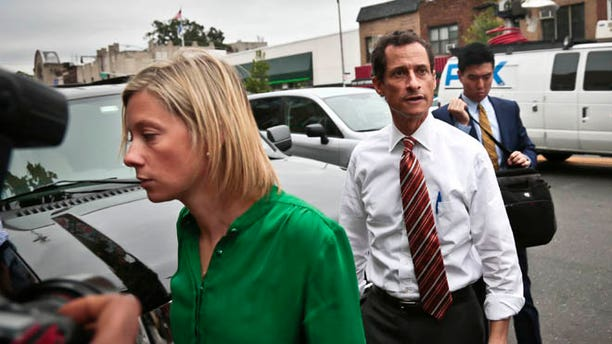 July 25: Anthony Weiner arrives with chief spokeswoman Barbara Morgan, left, who has been criticized after an interview she said she believed was off the record.