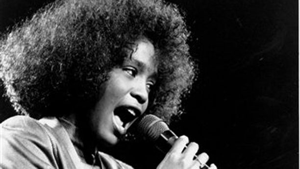 In this May 10, 1986, file photo, American singer Whitney Houston belts out a song during her segment of a benefit concert at Boston Garden. Houston died Saturday, Feb. 11, 2012, she was 48. (AP Photo/Elise Amendola)