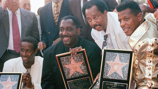 FILE - In this Sept. 14, 1994 file photo, The Temptations, from left to right, Theo Peoples, Otis Williams, Melvin Franklin, and Ali-Ollie Woodson, pose after being given a star on the Hollywood Walk of Fame in the Hollywood area of Los Angeles.