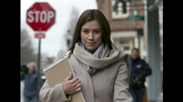 In this March 13, 2013 file photo, Alexis Wright, 30, leaves the Cumberland County Courthouse in Portland, Maine. Wright, a Zumba fitness instructor who pleaded guilty to using her Maine studio as a front for prostitution.