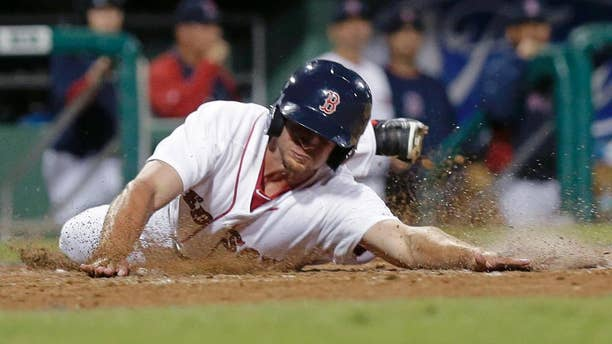 Boston Red Sox Jonathan Roof reaches home on an RBI double by Mike McCoy in the eighth inning of an exhibition baseball game against the Minnesota Twins in Fort Myers, Fla., Thursday, March 27, 2014. The Red Sox won 4-1. (AP Photo/Gerald Herbert)