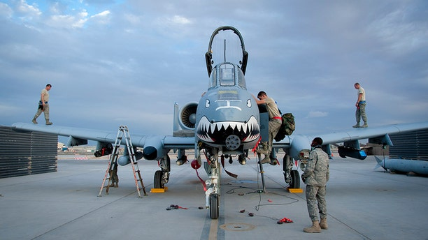Members of the 451st Expeditionary Maintenance Group perform a recovery on an A-10 Warthog at Kandahar Airfield, Afghanistan, Sept. 2, 2011.