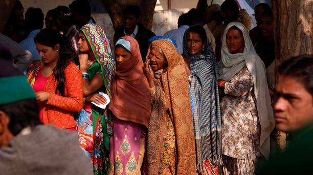 People wait in queues to cast their votes in New Delhi, India, Wednesday, Dec. 4, 2013. Nearly 12 million residents were expected to vote to select the assembly, in a poll that analysts say is expected to show a trend for the three parties heading into next year's national elections in the world's biggest democracy. (AP Photo/Saurabh Das)