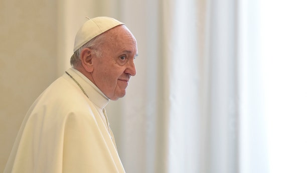 Pope Francis stands during the audience with Ecuador's President Lenin Moreno at the Vatican, Saturday, Dec. 16, 2017.