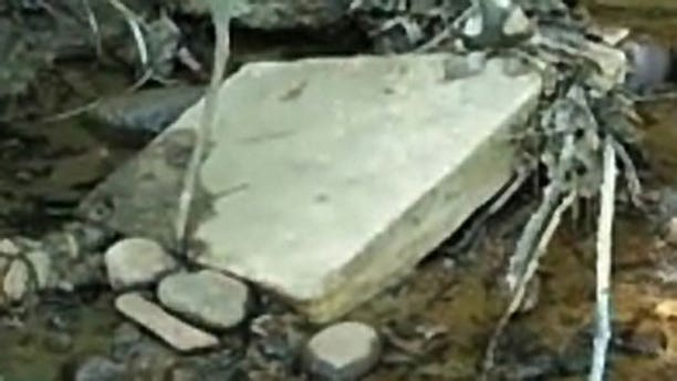Discarded headstones were recently found in a creek bed near Arlington National Cemetery.