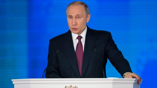Russian President Vladimir Putin gives his annual state of the nation address in Manezh in Moscow, Russia, Thursday, March 1, 2018.
