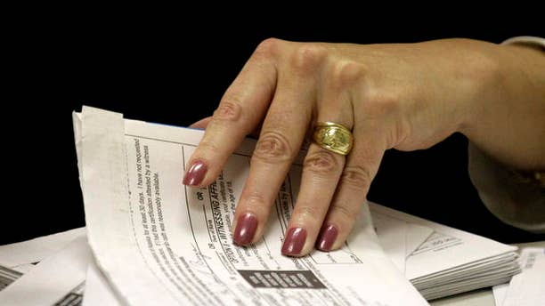 FILE: An undated picture of a U.S. voter filing out an absentee ballot.