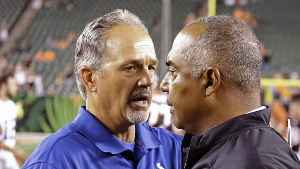 Indianapolis Colts head coach Chuck Pagano, left, meets with Cincinnati Bengals head coach Marvin Lewis after the Bengals defeated the Colts 35-7 in an NFL preseason football game, Thursday, Aug. 28, 2014, in Cincinnati. (AP Photo/Tom Uhlman)