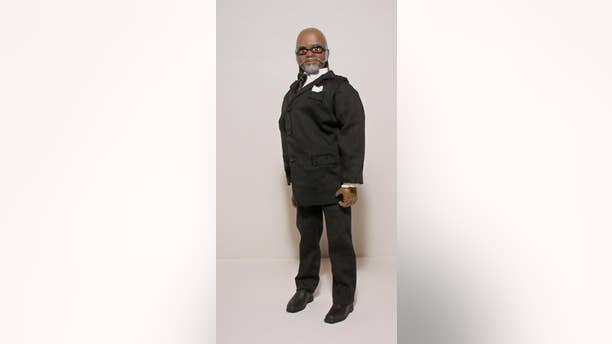 """In this undated photo released by herobuilders.com, the Jimmy McMillan """"The Rent is Too Damn High"""" doll is shown. Herobuilders.com, a Connecticut company that makes action figures is selling one of New York governor wannabe. (AP Photo/Herobuilders.com)"""