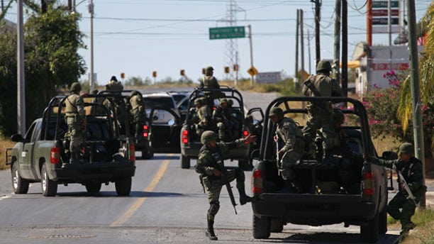Nov. 19: Mexican soldiers inspect a home as residents flee border towns up and down the Rio Grande valley.