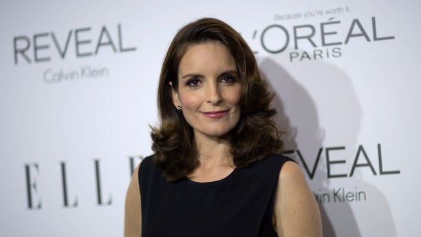 Tina Fey poses at the 21st annual ELLE Women in Hollywood Awards in Los Angeles.