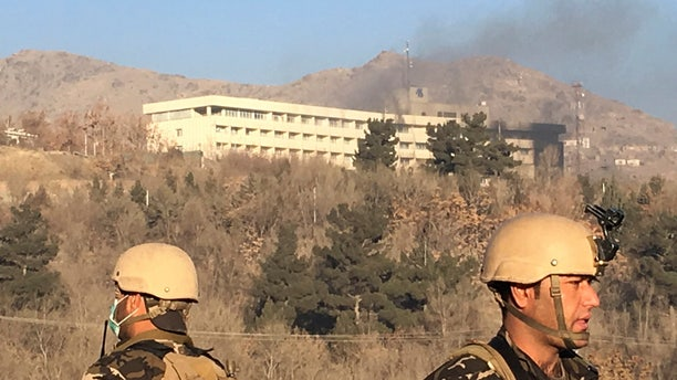 Smokes rises from the Intercontinental Hotel after an attack in Kabul, Afghanistan, Sunday, Jan. 21, 2018.