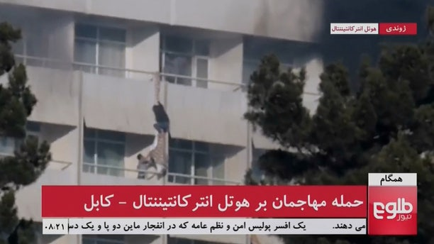 A man is seen using sheets to climb out of a balcony railing at Kabul's Intercontinental Hotel, after gunmen attacked the hotel, in Kabul, Afghanistan, in this still image taken from a video supplied by TOLOnews January 21, 2018.