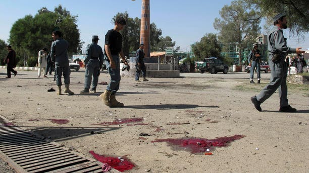 Oct. 1, 2012 - Afghan police secure the site of a suicide bombing in Khost, south of Kabul, Afghanistan.