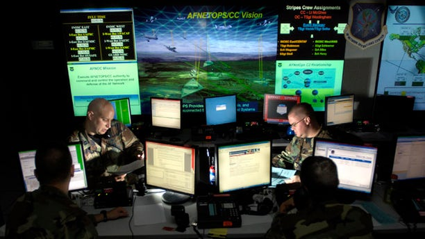 July 17, 2007: Capt. Jason Simmons and Staff Sgt. Clinton Tips update anti-virus software for Air Force units to assist in the prevention of cyberspace hackers at Barksdale Air Force Base, La.
