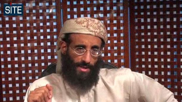 Monday, Nov. 8, 2010 file image taken from video and released by SITE Intelligence Group, Anwar al-Awlaki speaks in a video message posted on radical websites.