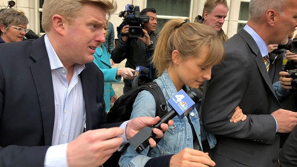 'Smallville' actress Allison Mack leaves court on bail after arrest over involvement in sex cult.