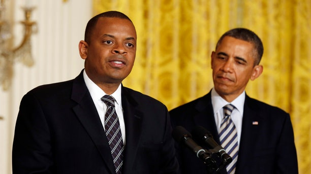 U.S. President Barack Obama listens to Charlotte, N.C., Mayor Anthony Foxx after naming him to replace Ray LaHood as U.S. Transportation Secretary in the East Room of the White House in Washington.