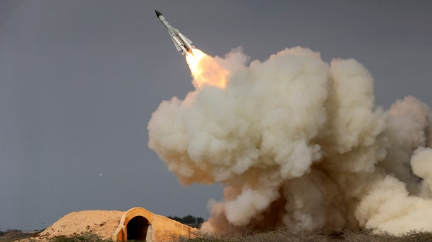 In this Dec. 29, 2016 file photo, released by the semi-official Iranian Students News Agency (ISNA), a long-range S-200 missile is fired in a military drill in the port city of Bushehr, on the northern coast of Persian Gulf, Iran.