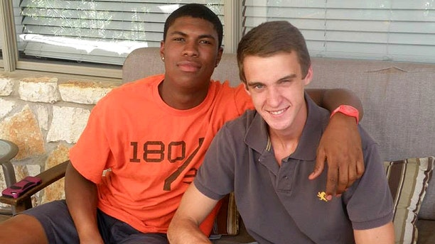 In this 2016 photo provided by John Gramlich shows, Bakari Henderson, left, with friend Travis Jenkins, in Austin, Texas. Henderson, of Austin and recent graduate from the University of Arizona, was beaten to death early Friday, July 7, 2017, at a bar in Lagana on the Greek island of Zakynthos.