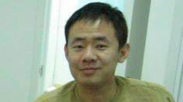This 2009 handout photo released by a friend of Xiyue Wang, shows Xiyue Wang at his apartment in Hong Kong, China.