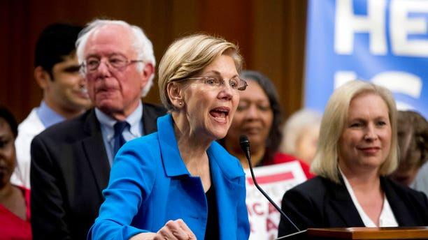 Sen. Elizabeth Warren, D-Mass., speaks in support of Sanders' Medicare for All legislation.