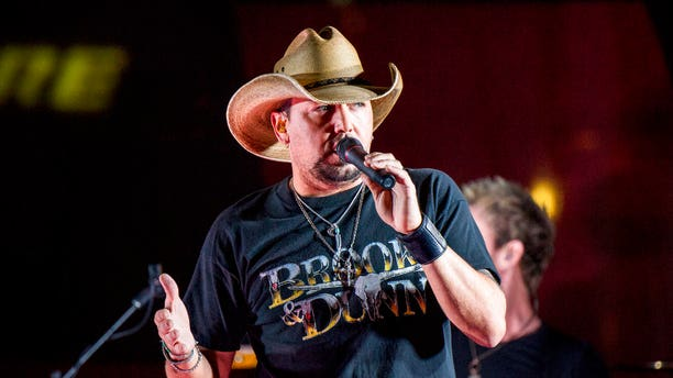 FILE - In this June 7, 2017 file photo Jason Aldean performs during a surprise pop up concert at the Music City Center in Nashville, Tenn. Aldean was the headlining performer when a gunman opened fire at a music festival on the Las Vegas Strip on Sunday, Oct. 1. (Photo by Amy Harris/Invision/AP, File)