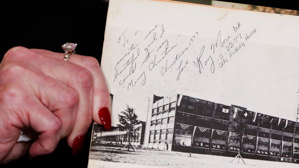 Beverly Young Nelson the latest accuser of Alabama Republican Roy Moore, shows her high school yearbook signed by Moore, at a news conference, in New York, Monday, Nov. 13, 2017. Nelson says Moore assaulted her when she was 16 and he offered her a ride home from a restaurant where she worked.