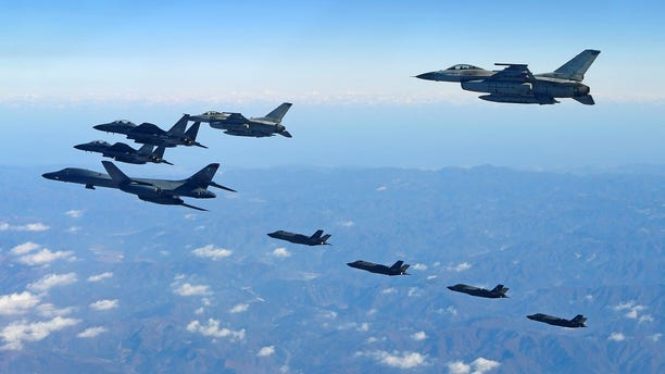 U.S. Air Force B-1B bomber, South Korea and U.S. fighter jets fly over the Korean Peninsula during the combined aerial exercise, South Korea, Wednesday.