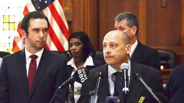 Jersey City Police Chief Michael Kelly, right, spoke at a press conference Friday morning in Jersey City, N.J., regarding Jersey City Police Lt. Christopher Robateau who was was killed on the New Jersey Turnpike early Friday morning. Seen to his left is Jersey City Mayor Steve Fulop.