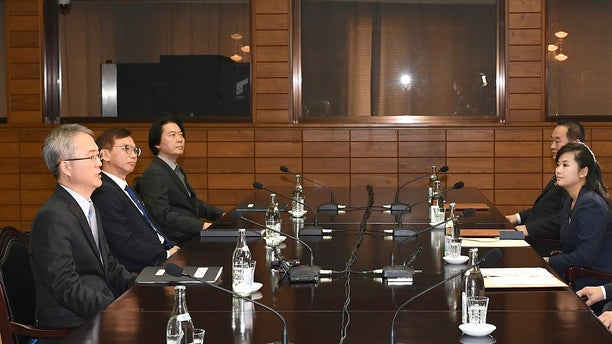 Officials from the Koreas met Monday to work out details about North Korea's plan to send an art troupe to the South during next month's Winter Olympics. Hyon Song Wol, the head of the Moranbong Band, second right, also attended the meeting.