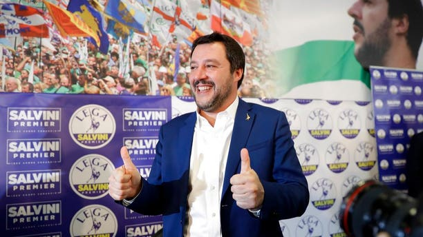 Right-wing, anti-immigrant and euroskeptic League's Matteo Salvini gives the thumbs up at the end of a press conference on the preliminary election results, in Milan, Monday, March 5, 2018. The League jumped from 4 percent of the vote five years ago to nearly 18 percent in Sunday's vote, ahead of Forza Italia, which had nearly 14 percent.