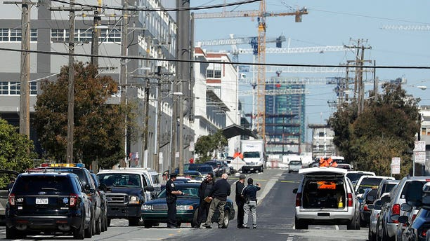 San Francisco Police officers work near where police say a driver got into an altercation with several people and struck them with his vehicle before fleeing in San Francisco, Wednesday, March 28, 2018.