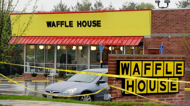 Police tape blocks off a Waffle House restaurant on April 22 in Tennessee