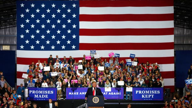 President Donald Trump speaks during a campaign-style rally in Washington, Mich., April 28, 2018.