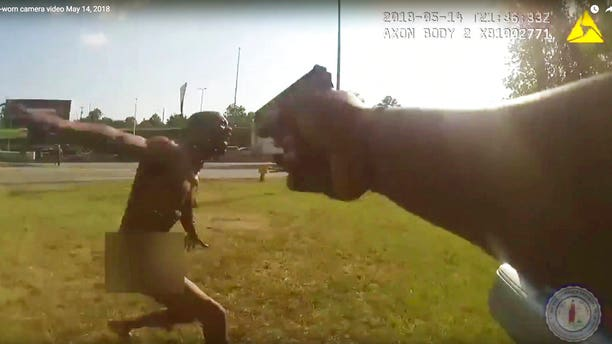 This still image taken from the Richmond, Va., Police body camera shows a police officer pointing his gun at Marcus-David Peters on May 14, 2018, in Richmond, Va.
