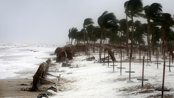Strong waves and wind pound a beach after Cyclone Mekunu in Salalah, Oman.
