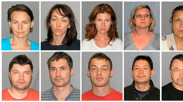 This file photo combo of 10 undated booking photos, provided by U.S. Marshals, includes Tracey Ann Foley, top row second from right, whose real name is Elena Vavilova, after the FBI arrested her and nine others in 2010 for being Russian spies. Also pictured are: from top left, Cynthia Murphy whose real name is Lydia Guryev, Patricia Mills whose real name is Natalia Pereverzeva, Anna Chapman, Vavilova, Vicky Pelaez. Bottom row from left: Richard Murphy born Vladimir Guryev, Michael Zottoli whose real name is Mikhail Kutsik, Mikhail Semenko, Donald Howard Heathfield whose real name is Andrey Bezrukov and Juan Lazaro whose real name is Mikhail Vasenkov.