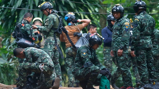 Thai rescuers prepare to enter the cave where 12 boys and their soccer coach have been trapped since June 23, in Mae Sai, Chiang Rai province, in northern Thailand Friday, July 6, 2018.