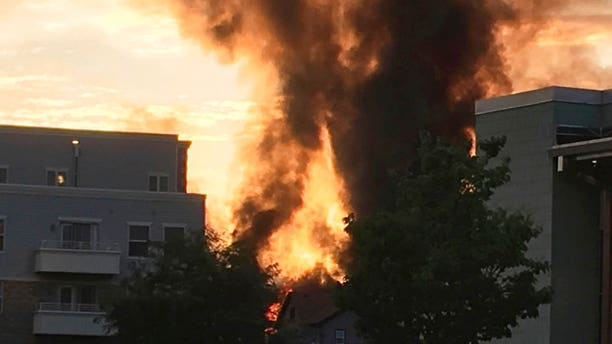 A large plume of smoke from a massive fire is seen in Sun Prairie, Wis., Tuesday.