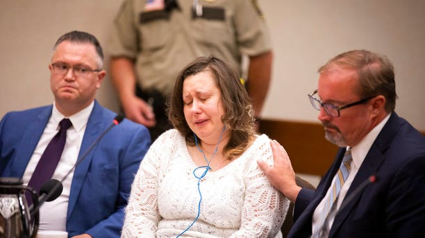 Nataliia Karia, center, with her lawyers Brock Hunter, right, and Ryan Else, reacts during her sentencing hearing in Hennepin County District Court in Minneapolis, Monday, July 16, 2018.