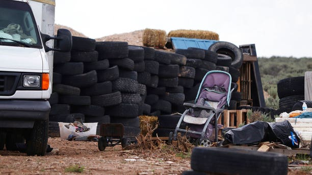 The makeshift compound — located near the Colorado border — was found shielded by old tires, wooden pallets and other debris.