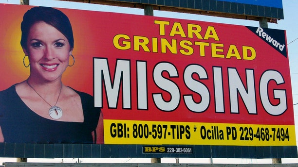 A photo of missing teacher Tara Grinstead is seen on a billboard in Ocilla, Georgia, in 2006.