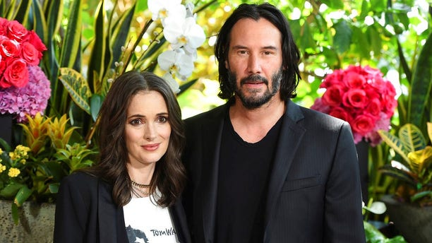 """Winona Ryder said she and Keanu Reeves may be married in real life after a Romanian priest performed the ceremony in the """"Dracula"""" scene."""