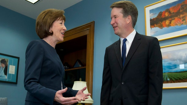 Sen. Susan Collins, R-Maine, speaks with Supreme Court nominee Judge Brett Kavanaugh at her office, before a private meeting on Capitol Hill in Washington, Aug. 21, 2018.