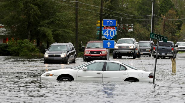 Drivers tried to navigate a flooded road leading to Interstate 40 in Castle Hayne, N.C., after damage from Florence cut off access to Wilmington, N.C., on Sunday.