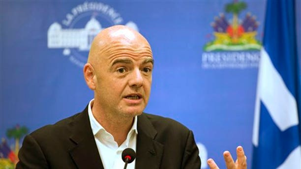 President of FIFA Gianni Infantino hosts a press conference in Haiti in April 2017.