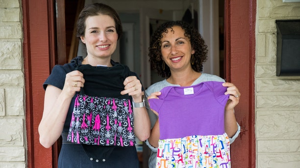 Eva St. Clair, left, and Rebecca Melsky pose for a portrait at Melsky's home in Washington. Melsky and St. Clair design dresses for Princess Awesome, a girls' clothing line that uses traditional boys' motifs such as trains, dinosaurs, ninjas, and planes.
